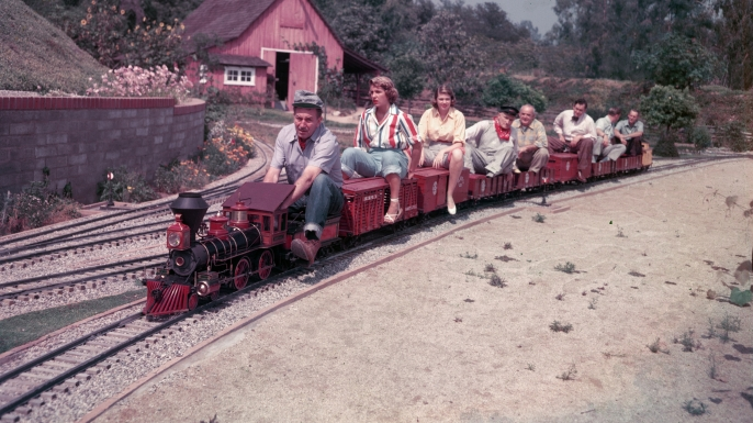Photo of Walt Disney on train similar to one planned for Lilliputian Land. (Credit: Gene Lester/Getty Images)