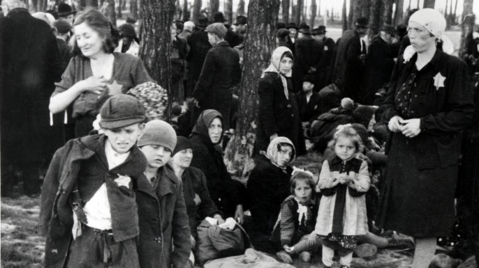 The arrival of Hungarian Jewish people to Auschwitz-Birkenau in 1944. Gisella Perl was sent to Auschwitz from Hungary. Most were sent immediately to the gas chambers by Dr Josef Mengele. (Credit: Galerie Bilderwelt/Getty Images)