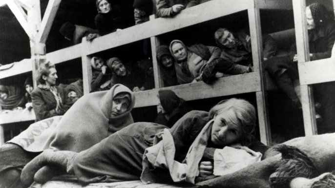 Women in the barracks at Auschwitz, Poland, January 1945. Photo taken by a Russian photographer shortly after the liberation of the camp.  (Credit: Galerie Bilderwelt/Getty Images)