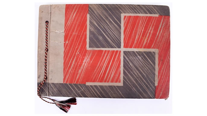 The photo album cover, with engraved swastika. (Credit: C&T Auctions)