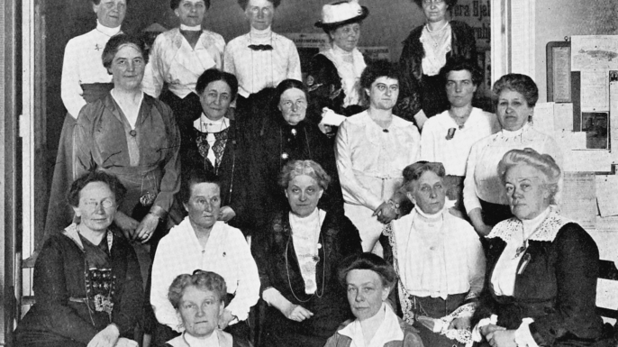 International Woman Suffrage Alliance, 1914. In centre of seated row is Carrie Chapman Catt, American feminist leader. 2nd from left Millicent Garrett Fawcett. (Credit: Ann Ronan Pictures/Print Collector/Getty Images)