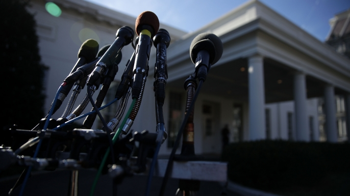 Microphones set up outside the White House.