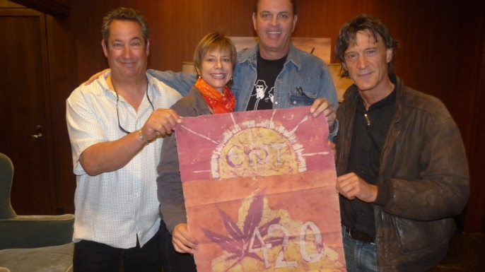 Three Waldos—(from left) Mark Gravitch, Dave Reddix and Steve Capper with their original 420 flag and friend Patty Young. (Credit: Carly Schwartz)