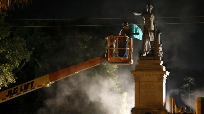 Workers prepare to take down the Jefferson Davis statue in New Orleans, Thursday, May 11, 2017. This was the second of four Confederate monuments slated for removal in a contentious process that has sparked protests on both sides. (AP Photo/Gerald Herbert)