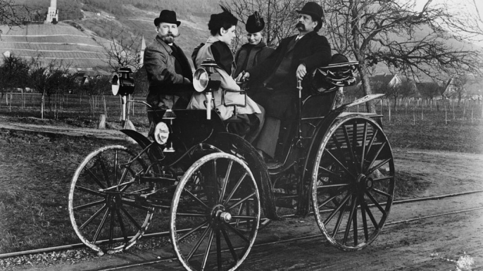 Karl Benz with his wife Bertha in a Benz-Viktoria, 1893. Karl Benz is on the right sitting next to his wife.