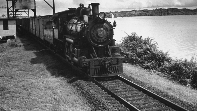 Railroad train following tracks beside Panama Canal.  (Credit: Thomas D. Mcavoy/The LIFE Picture Collection/Getty Images)
