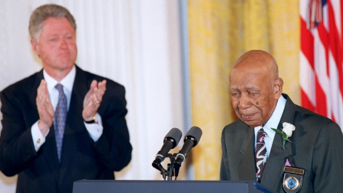 Herman Shaw speaks as President Bill Clinton looks on during ceremonies at the White House on May 16, 1997, during which Clinton apologized to the survivors and families of the victims of the Tuskegee Syphilis Study.