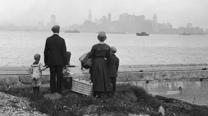An immigrant family on the dock at Ellis Island, c. 1925. (Credit: Bettmann/Getty Images)