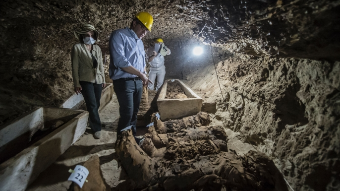 Egyptian Antiquities Minister Khaled el-Enany in front of mummies following their discovery earlier this week.
