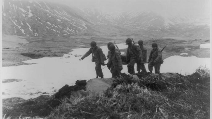 U.S. troops carrying a stretcher on Attu
