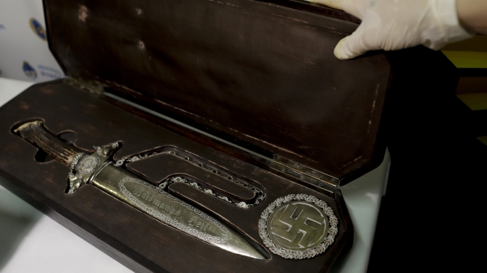 A knife with Nazi markings is seen at the Interpol headquarters in Buenos Aires, Argentina. (Credit: Natacha Pisarenko/ AP Photo)