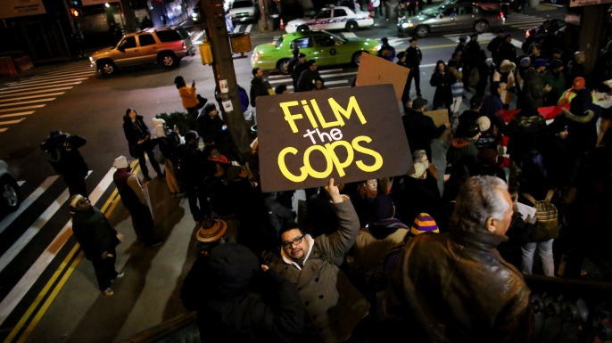 People gather on E. 125th St. during a protest December 4, 2014 in New York City. Protests began after a Grand Jury decided to not indict officer Daniel Pantaleo. (Credit: Yana Paskova/Getty Images)