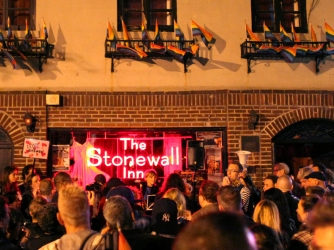 "People participate in Queer Rising's ""Take Back the Night"" gay rights march in front of The Stonewall Inn, New York City. (Yana Paskova/Getty Images)"