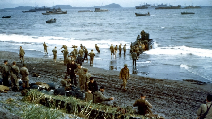 U.S. military personnel unloading supplies during a beach landing on the Aleutian Islands. (
