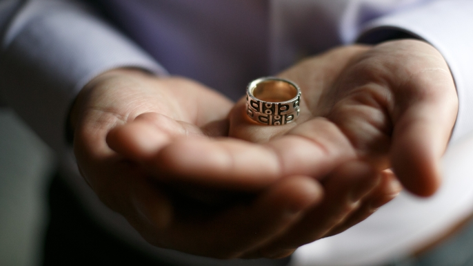 Jim Obergefell was married to his husband John Arthur on a medical jet in Maryland shortly before Arthur died of ALS. Obergefell holds his wedding band that has been fused together with Arthur's ashes and wedding ring. (Credit: Maddie McGarvey/For The Washington Post via Getty Images)