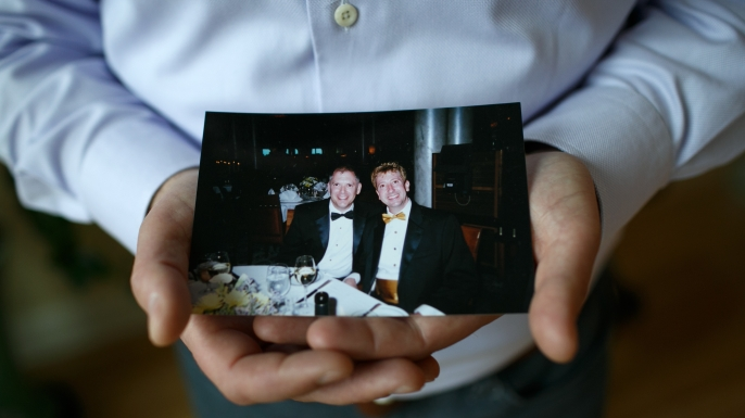 Jim Obergefell holds a photo of him and his late husband John Arthur in his condo in Cincinnati. Obergefell was married to his husband on a medical jet in Maryland shortly before Arthur died of ALS. Obergefell filed suit so he could be listed as the surviving spouse on the death certificate, which has turned into the Supreme Court case Obergefell v. Hodges. (Credit: Maddie McGarvey/For The Washington Post via Getty Images)