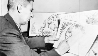 "Theodor ""Dr. Seuss"" Geisel at work on a drawing for ""How the Grinch Stole Christmas"" (Credit: Universal History Archive/UIG via Getty Images)"
