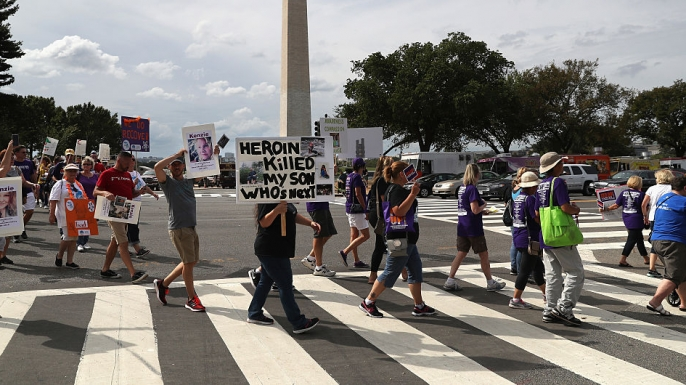 "Activists and family members of loved ones who died in the opioid/heroin epidemic march in a ""Fed Up!"" rally on the National Mall on September 18, 2016."