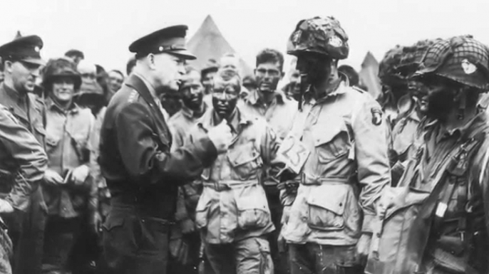Allied Supreme Commander Dwight Eisenhower speaking with troops before the invasion of Normandy.