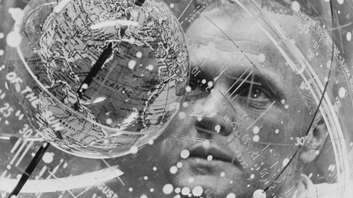 John Glenn looks into a Celestial Training Device during training in 1961.