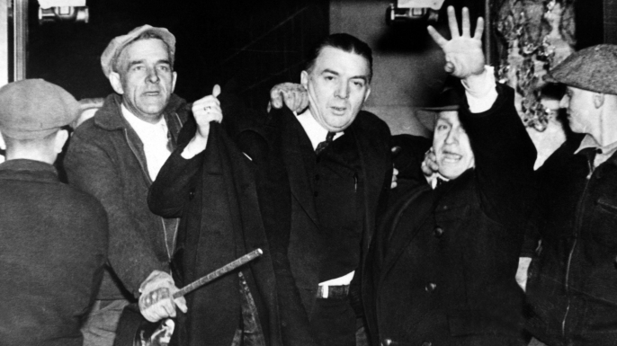 Miles Sweeney, one of the strike leaders at the Hershey Chocolate Plant, being ejected by a mob of non-striking workers and local farmers. (Credit: Everett Collection Historical/Alamy Stock Photo)