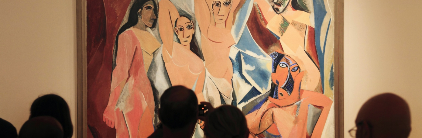Visitors in front of Pablo Picasso's Les Demoiselles d'Avignon in Museum of Modern Art, New York City. (Credit: Age Fotostock/Alamy Stock Photo)