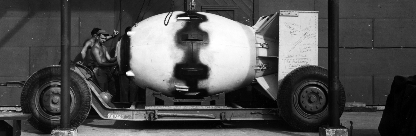 View of the atomic bomb, codenamed 'Fat Man,' as it is lowered onto a trailer cradle, early August, 1945, before it was dropped on the Japanese city of Nagasaki on August 9. (Credit: PhotoQuest/Getty Images)