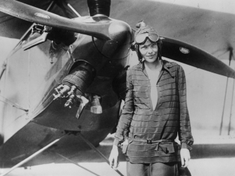 """Amelia Earhart stands June 14, 1928 in front of her bi-plane called """"Friendship"""" in Newfoundland. (Credit: Getty Images)"""