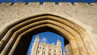 An arch from its surrounding walls encloses the White Tower in London's iconic Tower of London. (Credit: David Callan/Getty Images)