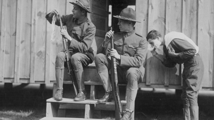 U.S. soldiers cleaning their rifles at a training camp in Plattsburg, New York during World War I. (Credit: Paul Thompson/FPG/Getty Images)
