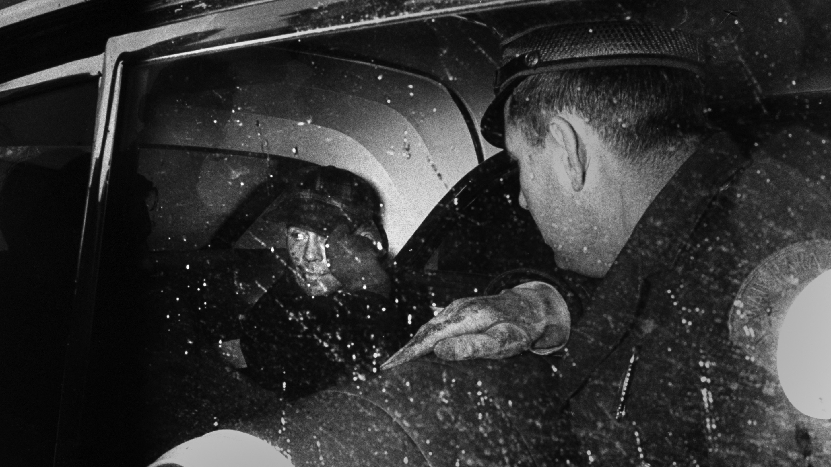 Serial Killer Ed Gein sitting in back of police car after ...
