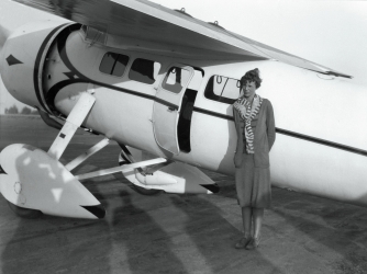 Amelia Earhart as she prepares for the flight that would set an unofficial speed record for flyers, by putting her Lockheed plane at 184.17 miles per hour, the record was 156 miles an hour. (Credit: Bettmann/Getty Images)