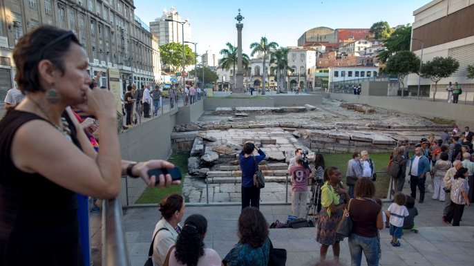 People remain at Valongo Wharf after it was added to the list of UNESCO World Heritage sites, in Rio de Janeiro, Brazil on July 10, 2017. The committee of the UN cultural body said Valongo was a reminder of an estimated 900,000 African slaves who were brought there by traders starting in 1811. (Credit: Mauro Pimentel/AFP/Getty Images)