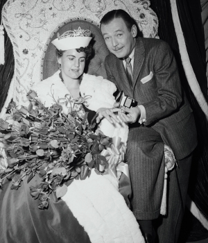 """Miss Wilhelmina Van Son, 27, elected """"Queen for a Day"""" on the NBC-TV with emcee Jack Bailey. She won a flight to Florida along with an engagement-wedding ring ensemble. Once in Florida, a Navy helicopter would fly her aboard the USS Randolph, an aircraft carrier on which she would meet the 2,500-man crew in hopes of finding a husband. (Credit: Bettmann/Getty Images)"""