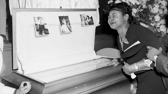 Mamie Mobley, mother of Emmett Till, at her son's casket at a Chicago funeral home. Images of his battered body helped spark the civil rights movement. (Credit:Chicago Sun-Times/AP Photo)
