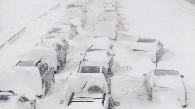 Hundreds of cars seen stranded on Lake Shore Drive during a massive winter blizzard in Chicago that left motorists sitting in their cars for hours or had them trudging through the snow to safety. (Credit: Kiichiro Sato/AP Photo)