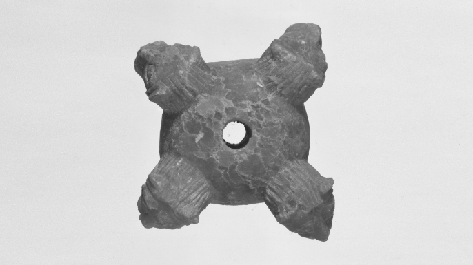 Mesopotamian clay mace head artifact from Tell Agrab, Iraq. (Courtesy of the Oriental Institute of the University of Chicago)
