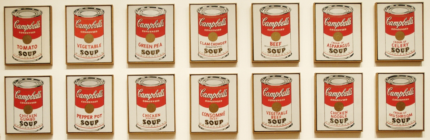 Visitor of the Museum of Modern Art in New York City looking at Campbell's Soup Cans by Andy Warhol. (Credit: Age Fotostock/Alamy Stock Photo)