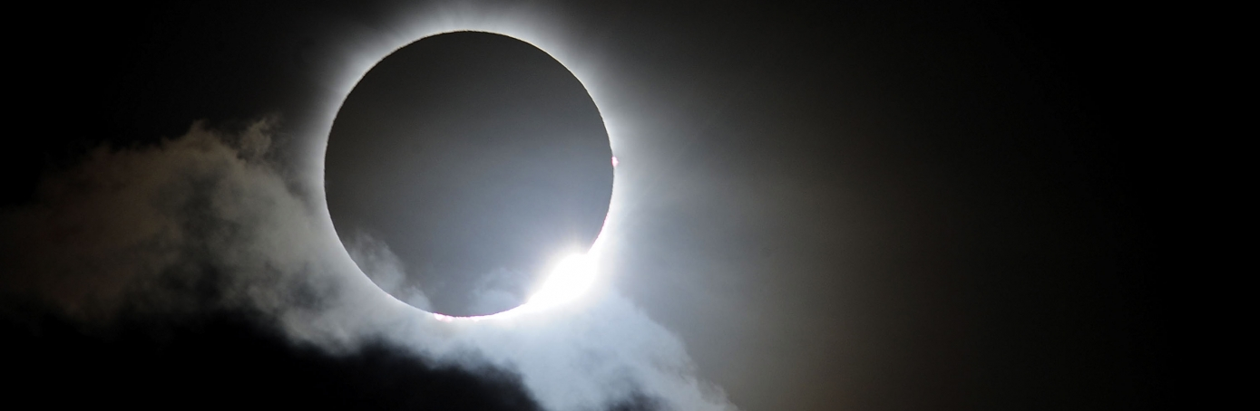 Solar eclipse at Palm Cove, Australia, 2012.  (Credit: Ian Hitchcock/Getty Images)