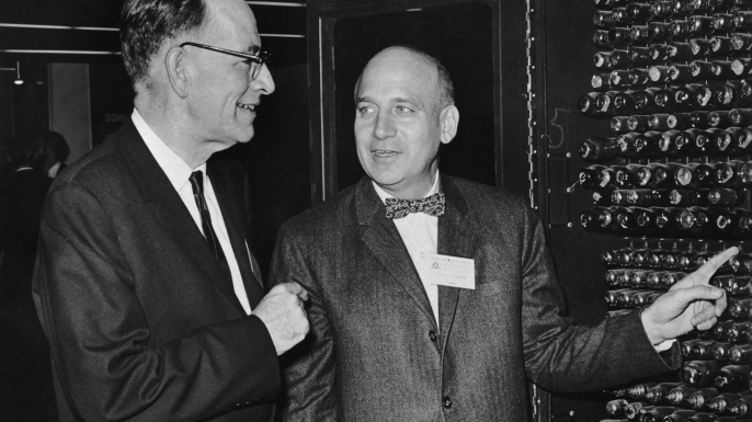John Mauchly and Dr Presper Eckert Jr looking at a portion of ENIAC, which they co-designed in 1946. (Credit: Hulton Archive/Getty Images)