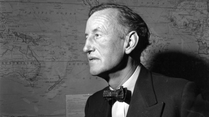 Ian Fleming (1908 - 1964), British author and creator of the character James Bond, in his study. (Credit: Express/Express/Getty Images)