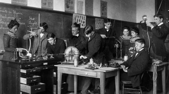 Native-American students and their teacher conduct physics experiments at the Carlisle Indian School in Carlisle, Pennsylvania, 1915. (Credit: PhotoQuest/Getty Images)