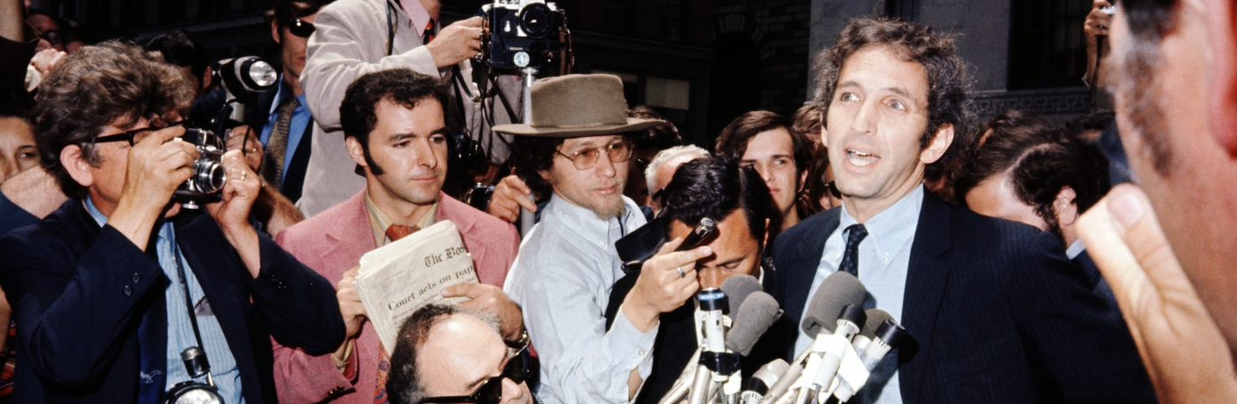 Massachusetts Institute of Technology research associate Daniel Ellsberg appears before microphones, surrounded by reporters at the Federal Building. Ellsberg, who had admitted supplying the New York Times with secret Pentagon papers, surrendered to Federal authorities June 26th.