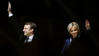 French President Emmanuel Macron next to his wife Brigitte Trogneux in front of the Pyramid at the Louvre Museum in Paris after the second round of the French presidential election, 2017. (Credit: Patrick Kovarik/AFP/Getty Images)