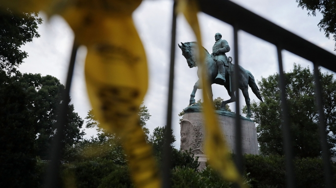 The statue of Confederat Gen. Robert E. Lee in the center of Emancipation Park the day after the Unite the Right rally devolved into violence August 13, 2017 in Charlottesville, Virginia. The Charlottesville City Council voted to remove the statue and change the name of the space from Lee Park to Emancipation Park, sparking protests from members of the 'alt-right.'  (Credit: Chip Somodevilla/Getty Images)