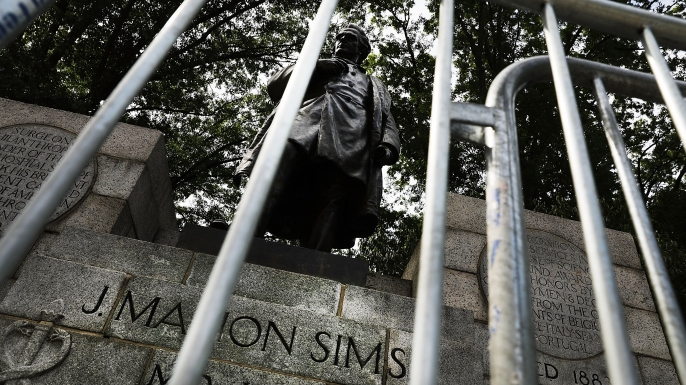 A statue of J. Marion Sims. Following the violence in Charlottesville, Virginia, many politicians, activists and citizens are calling for monuments dedicated to Confederate-era and other controversial figures to be taken down. (Credit: Spencer Platt/Getty Images)