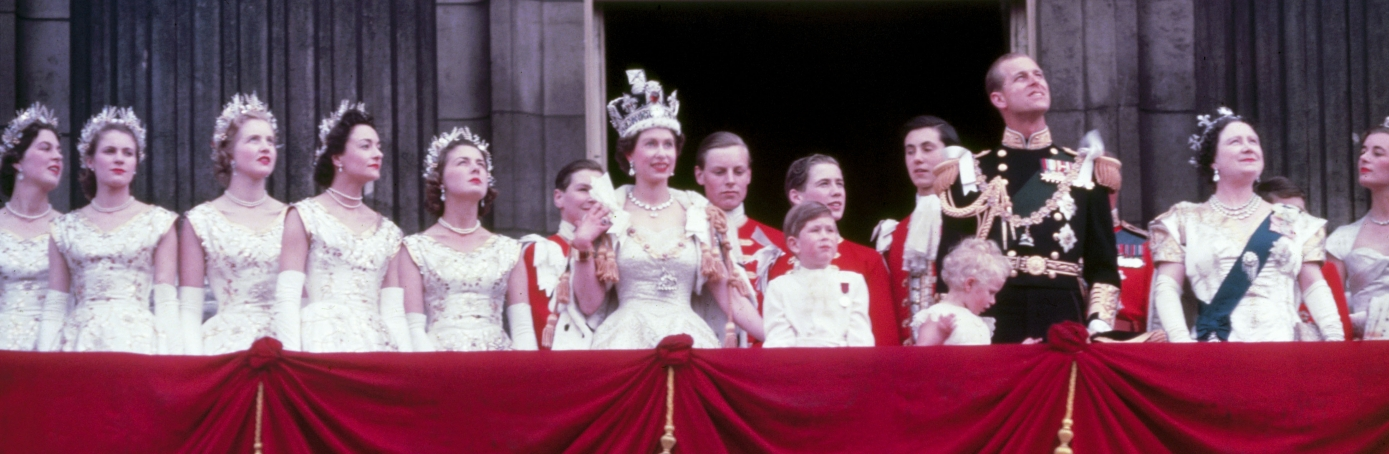 Queen Elizabeth II on the balcony at Buckingham Palace after her coronation in 1953. (Credit: Fox Photos/Hulton Archive/Getty Images)