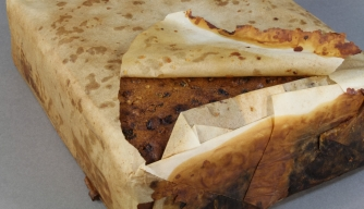 Fruit cake found at Cape Adare thought to be from Scott's Northern Party, 1911. (Credit: Antarctic Heritage Trust)