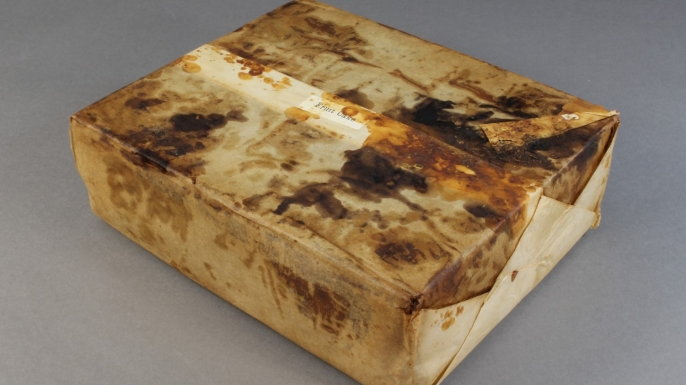 Huntley and Palmer's fruit cake in wrapper found in Cape Adare. (Credit: Antarctic Heritage Trust)