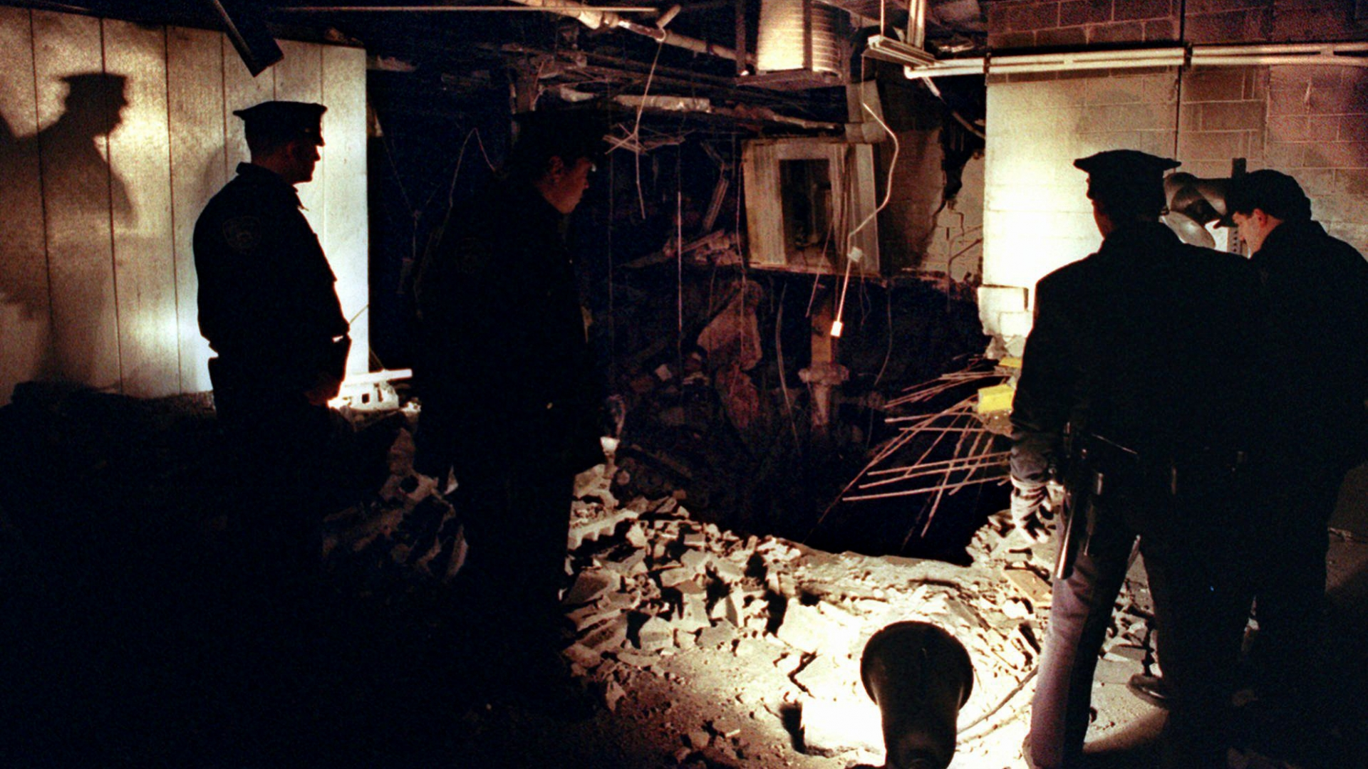 New York City Police officers view the damage caused by a truck bomb that exploded in the garage of New York's World Trade Center, 1993, that killed six people and injured more than 1,000. (Credit: Richard Drew/AP/REX/Shutterstock)